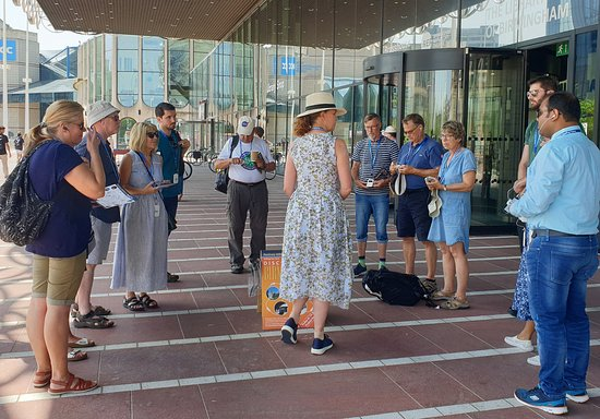 Our walking tours run all through the year. Tour Guide Dawn is about to start off from outside the Library of Birmingham.
