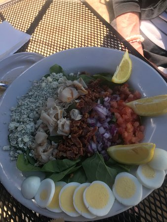 """Harbor Springs, MI: Cobb Salad - served over just spinach at the request of my friend - with no dressing, just extra blue cheese crumbles.  They were happy to make it """"her way""""."""
