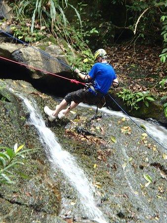 My husband rappelling Bocawina Falls