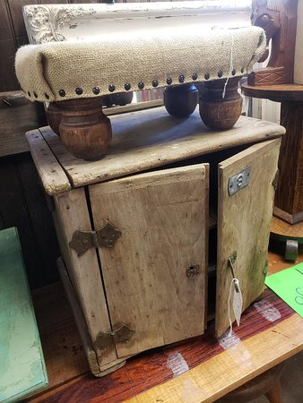 Cute primitive cabinet with shelves. Funky old hardware too. And look at that cute burlap covered stool....