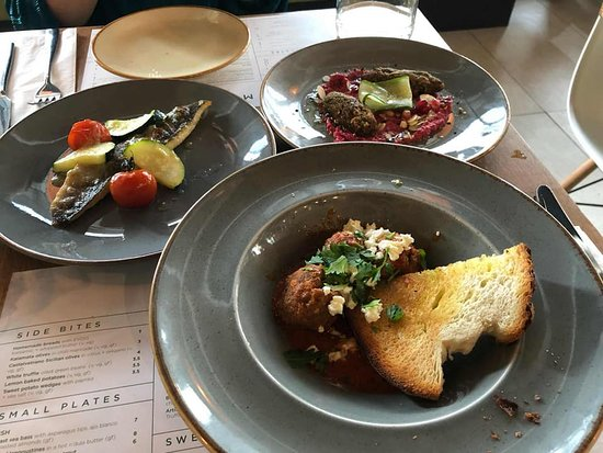 Lamb koftas with feta, falafel with beetroot, pomegranate and picked cucumber, sea-bass
