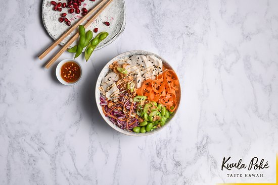 Kuula Poke: TAHINI MISO CHICKEN HOUSE BOWL.  Delicately poached chicken with coconut brown rice, superfood slaw, hickory carrot and edamame beans, drizzled with tahini miso and yuzu ponzu dressing.  With sriracha hot chilli on the side, for added heat!