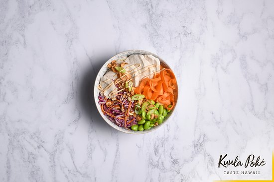 Kuula Poke: TAHINI MISO CHICKEN HOUSE BOWL.  Delicately poached chicken with coconut brown rice, superfood slaw, hickory carrot and edamame beans, drizzled with tahini miso and yuzu ponzu dressing.