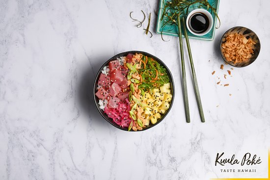 Kuula Poke: CLASSIC AHI TUNA HOUSE POKÉ BOWL.  Cubes of ahi tuna on a bed of white sushi rice with wakame seaweed, pickled red onion and pineapple, drizzled in our signature shoyu dressing.