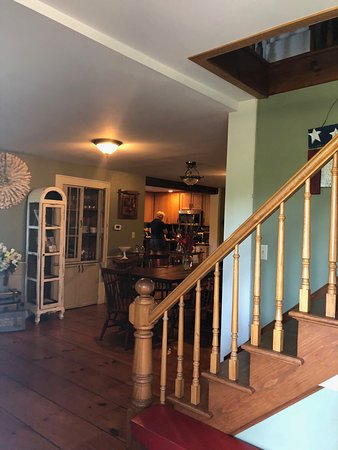The entry to The Hann Homestead is very inviting.  The flooring looks original to the house.
