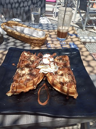 Waffle with chocolate was served to us after brunch! Delicious!