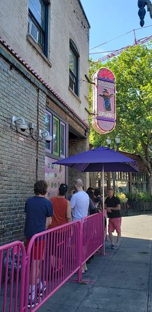 Voodoo Doughnut: Anticipation increased by menu on outside wall