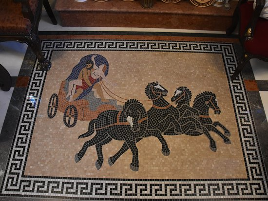 The Cultural and Geological Palace of Rhodes: The marmor moseique in the hall of the Cultural Palace of Rhodes (Greece). Plouton got the Persephone and goes to the UnterWorld with 4 black wirld  horses. Around the Greek Meandros