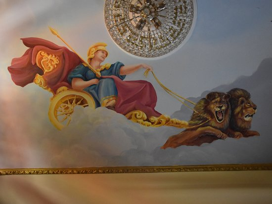 The Cultural and Geological Palace of Rhodes: The Gotnes Athena on carrieg of 2 lions, at the roof of Cultural Palace of Rhodes (Greece), painted by Angela Triantafyllos