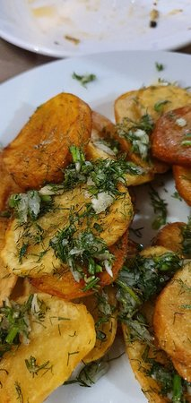 """Svishtov"": Fried home potatoes with garlic and dill"