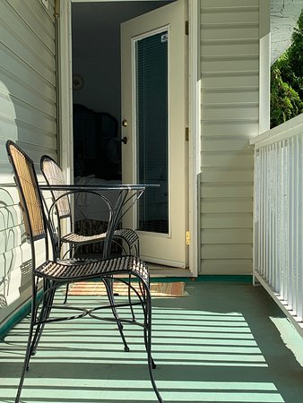 Upper suite at Crown House Bed & Breakfast. Outside deck table & chairs. Yogurt parfait for breakfast.