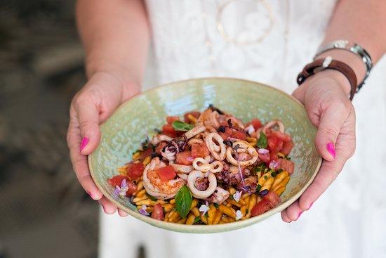 Strozzapreti with calamari, octopus, shrimp and fresh tomato concasse