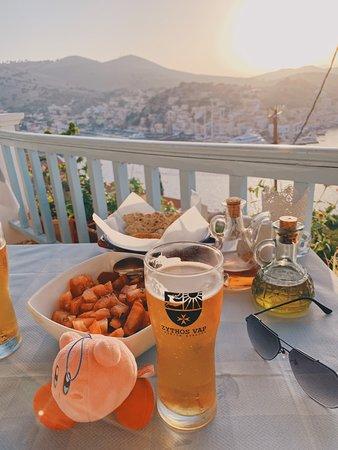 Haritomeni Taverna: Sunset view with my dinner.