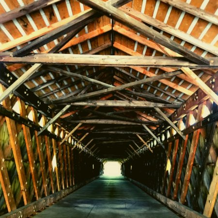 Scott Covered Bridge in Townshend. It's easy to pass right by it. Sometimes I think I should rename blog U-Turn Sally for as many moments I experience like this one. Scott Covered Bridge is known for three forms of support: a lattice truss, kingpost trusses, and laminated arches. It is closed to all traffic and only has room for about two cars to pull up next to it, but you can get out and walk across this
