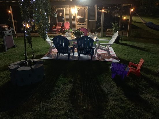 Private outdoor seating, backyard and grilling area for our Shawnee Accommodations at the Denmark Stage Stop House in Denmark Maine 04022