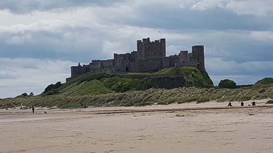 The stunning Bamburgh Castle taken from the vast expanse of white sandy beaches beneath its walls.......