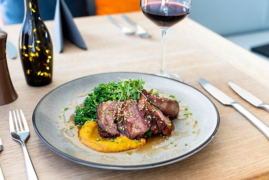 Pan roasted duck breast with a sticky Asian glaze served with a five-spice infused fondant potato, spiced carrot purée, tender stem broccoli, honey and soy dressing and toasted sesame seeds