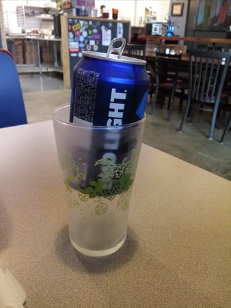 Beer can served in a glass.