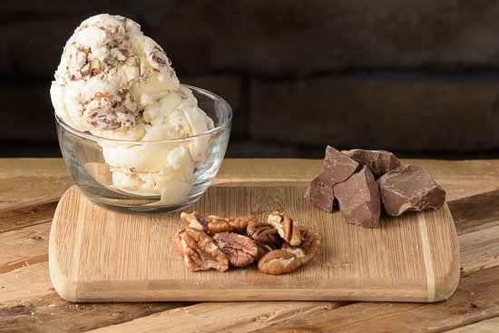 Water's Edge Chocolates, Inc.: Delicious Butter Pecan Ice Cream with Milk Chocolate.