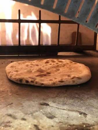 All our  pizzas are cooked in a red brick pizza oven