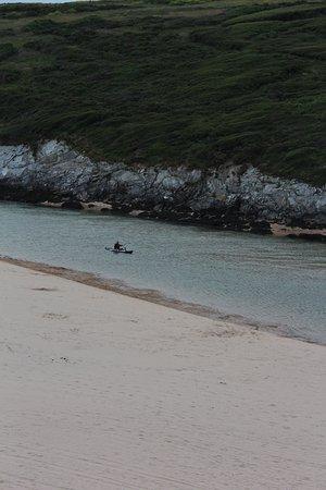 Crantock beach with man on a kayak