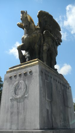 The Arts of Peace were sculpted by James Earle Fraser, an American sculptor. The Neoclassical statuary group consists of two separate elements, Music and Harvest and Aspiration and Literature, which frame the entrance to the Rock Creek and Potomac Parkway.