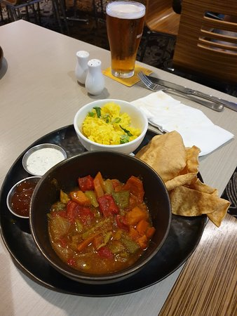 Hotel Maroochydore: VEGETABLE CURRY - Authentic Indian curry served with fluffy rice, mango chutney, raita and pappadum.
