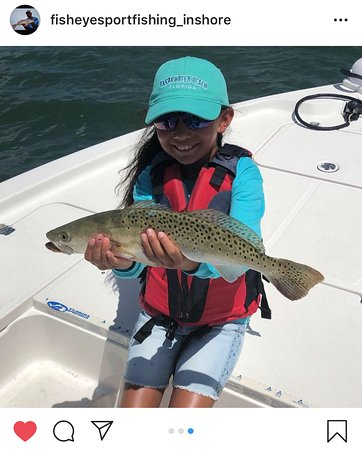 FishEye Sportfishing: Kids love fishing! Here's one of our young anglers holding a beautiful sea trout that she caught and released on today's inshore charter.