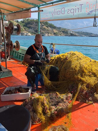 Fishing Tourism Kefalonia Michalis: What a Great Day! Our family enjoying the swim and oh my that Deliciousness Food Antonia and Michalis prepared. Hassan s the man in charge of the nets. Antonia is such a warm caring person as seen in the picture of her holding our grandson.