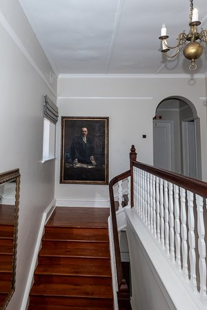 The stairs to the Deluxe and Standard Suites with General Louis Botha (who had the house built for his Irish wife Annie) at the top of the stairs keeping a keen eye