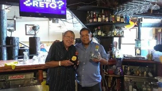 Fidel the owner of Vince's and I comparing Tequilas on June 29th