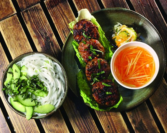 Coco Tang Oriental Cafe: Bun Cha - one of Hanoi's favourites: Traditional minced Pork Belly patties mixed with fresh Vietnamese Herbs and grilled to perfection on our coal BBQ, with Rice Noodles & home-made Fish Sauce dip on the side..