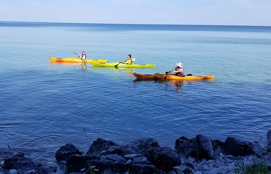 Arch Rock Adventure Kayak Tour: The Arch Rock side of Mackinac Island July 3 2019.Photographed from the shoreline