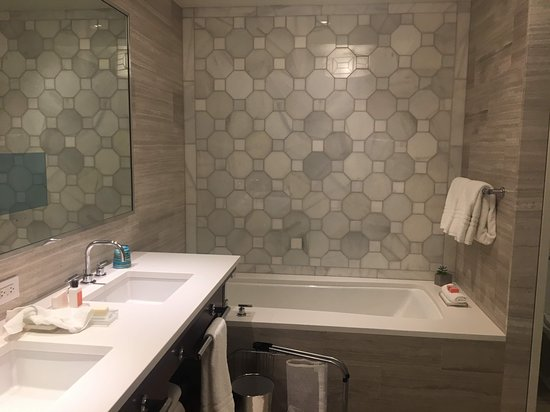 Bathroom had double sinks, soaking tub, glass enclosed shower, and separate toilet room