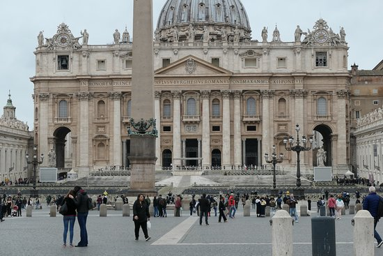 Close up across the square of the front of St Peter's Basilica