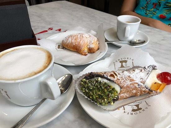 Sartoria Bakery Cafe: Pistachio cannolo and another shell shaped sweat pastry. Love at first sight