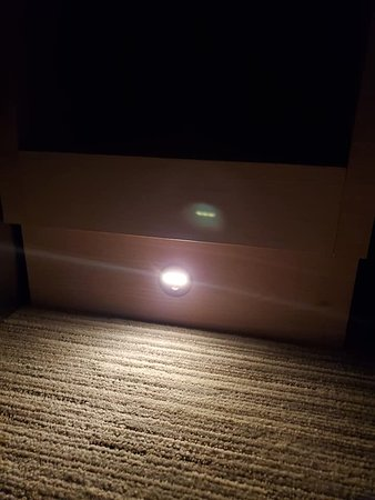 Sensor light on nightstand which helped to see your way in the room without waking your partner with a light in their face. All hotels need this. Pleasant surprise!!! I want this in my house. LOL