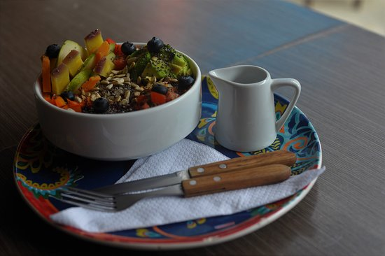 Healthy quinoa salad made with fresh fruit and veg straight from the market.