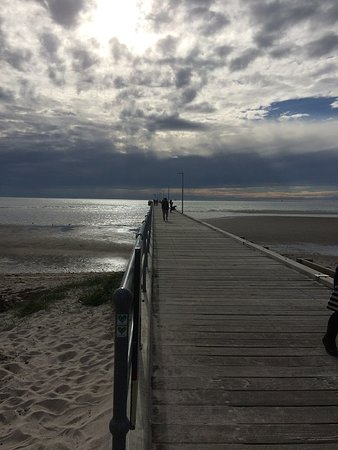 Walking Down The Pier Into A Storm