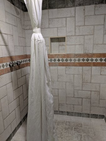 Shower curtain didn't contain the water so you need to be careful not slip on the floor outside fo the shower.