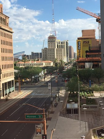 Beautiful morning view of downtown Phoenix. Love the American flag