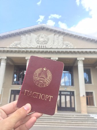 Transnistria passport with hammer and sickle and similar emblem of USSR!