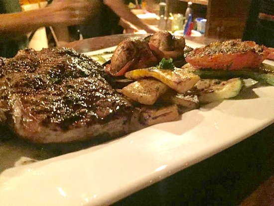 Rib Eye Chop grilled to perfection & grilled vegetables