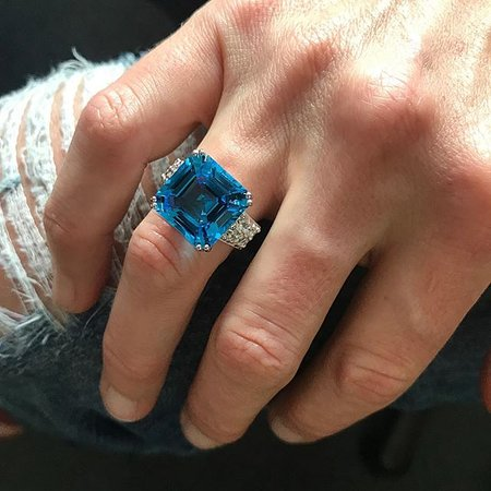 Square cut blue topaz ring with diamond detail.