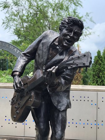 """The home where Chuck Berry lived, is on the list of National Historic Places.  Because his music had such an impact of Rock & Roll, we knew that we had to start our tour in St Louis at his home.  It's located in a working class neighborhood.  The nice lady next door was out grilling on her porch, greeted us to the neighborhood.  The second picture that I posted is from the backyard from the alley.  We also went to see his statue and mural in """"The Loop""""."""