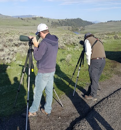 My son Hayden spotting a grizzly!  MacNeil setting up the other scope.