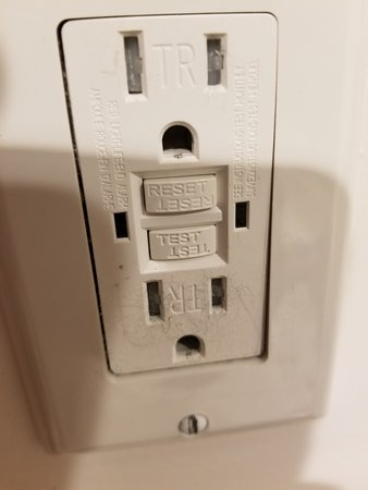 Master bathroom outlet that is plugged.