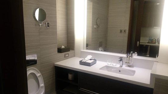 Clean, complete with mirror and plug for shaving and else.  Soap and lotion are fixed - so they provides with no limit
