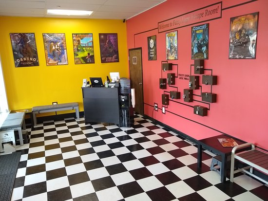 "Downers Grove, IL: Welcome to our spacious lobby where you can comfortably await your game and prepare for your adventure, including practicing on our Fuzzy Logic Lock Wall which is a ""tutorial mode"" that introduces different types of locks and puzzles teams may encounter in their games!"
