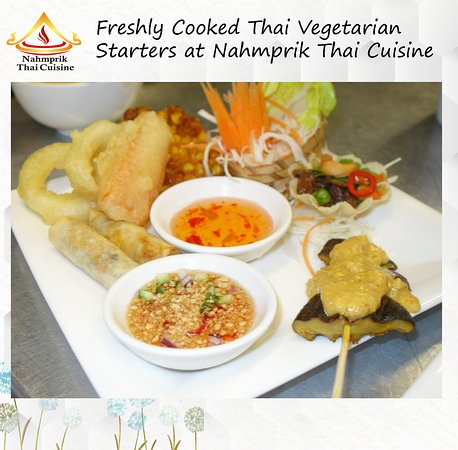 Freshly cooked Thai Vegetarian starters with delicious vegetarian golden crispy basket and myriad of vegetables, grilled mushrooms with satay sauce among others. Deliciously made!